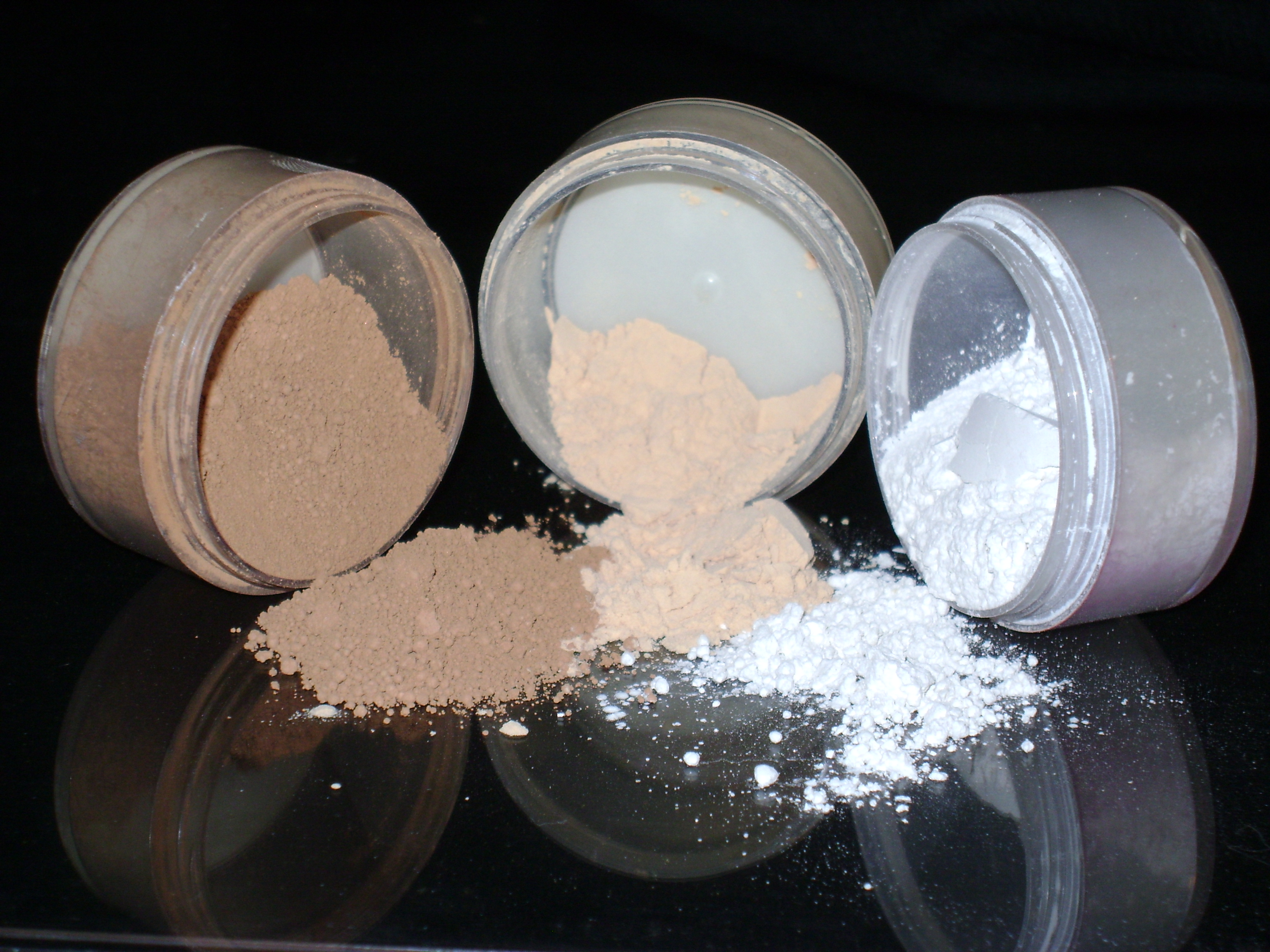 Three containers of powdery makeup CC via Wikimedia Commons